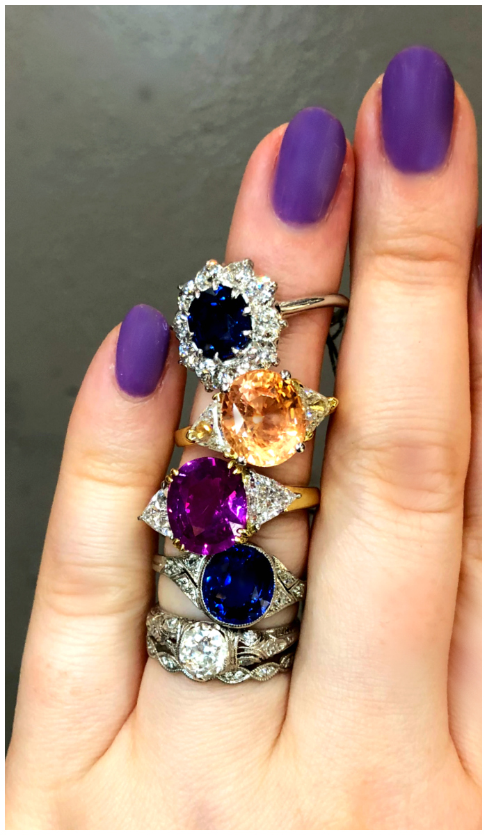 A stack of sapphire engagement rings from Under the Crown jewelry. Some vintage, some newer, all fantastic.