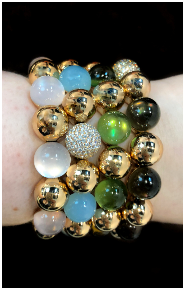 A wonderful stack of bracelets by gioielliamo!! Gems and gold. Beautiful Italian design!