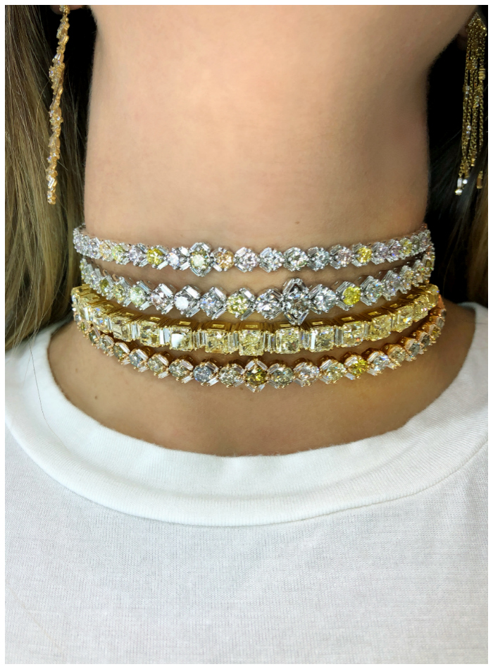 A stack of incredible, one-of-a-kind diamond chokers by Suzanne Kalan!