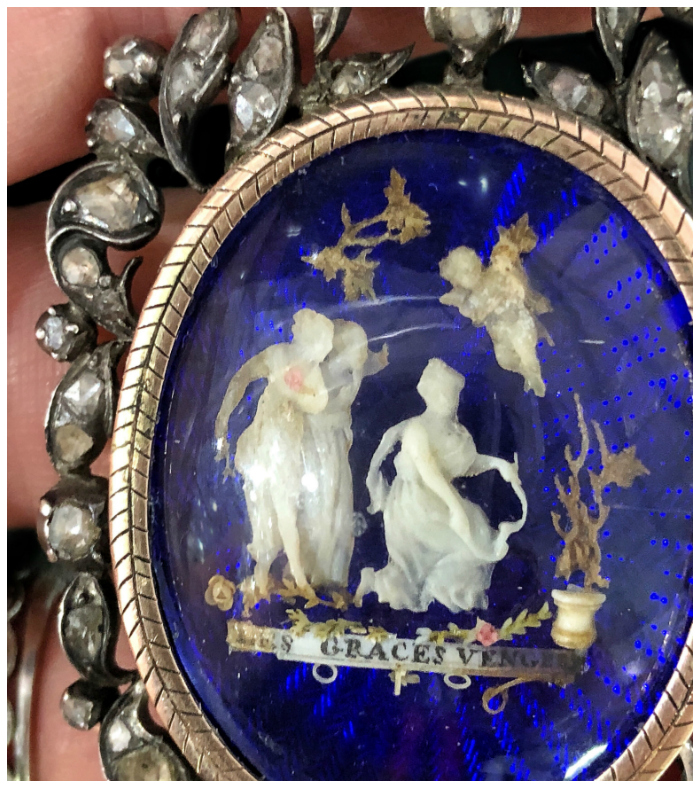 An exquisite, intricate Georgian era pendant showing a tiny ivory scene with the Three Graces. At Roy Rover Antiques!