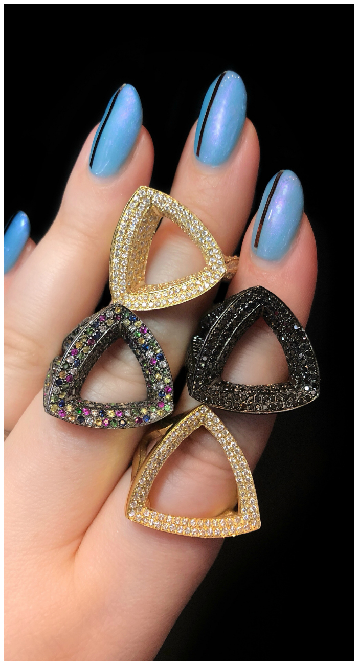 I love these rings by Karma El Khalil! Diamonds, black diamonds, and colorful sapphires in gold.