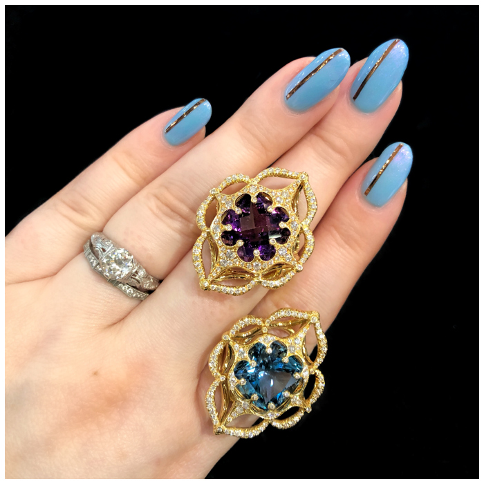 Two beautiful Erica Courtney rings! Glowing gemstones in gold and diamonds.