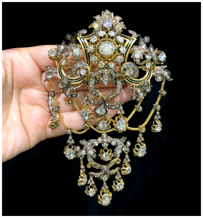 A breathtaking Victorian era brooch from Poli Trading Co. Diamonds in yellow gold with enamel detailing.