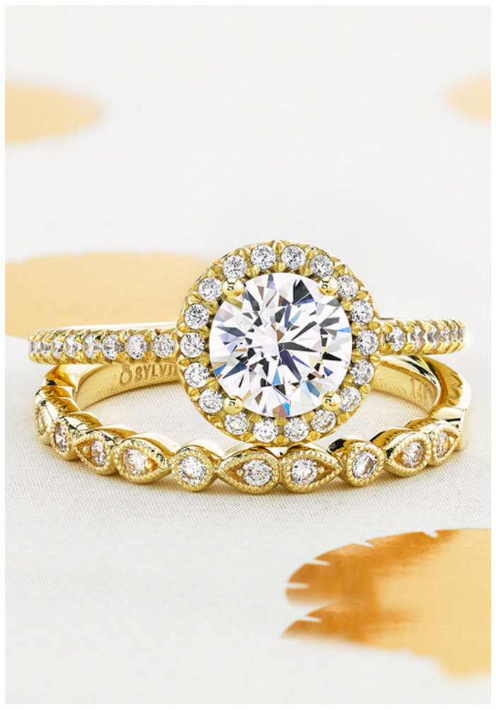 A yellow gold wedding set by Sylvie Collection. I love this wedding band with this engagement ring! A classic round brilliant diamond with a halo.
