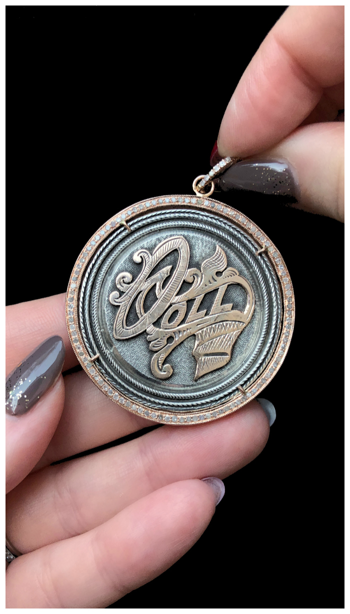 An extraordinary Victorian era love pendant token by Heavenly Vices! This one says 'Doll,' with rose gold accents.