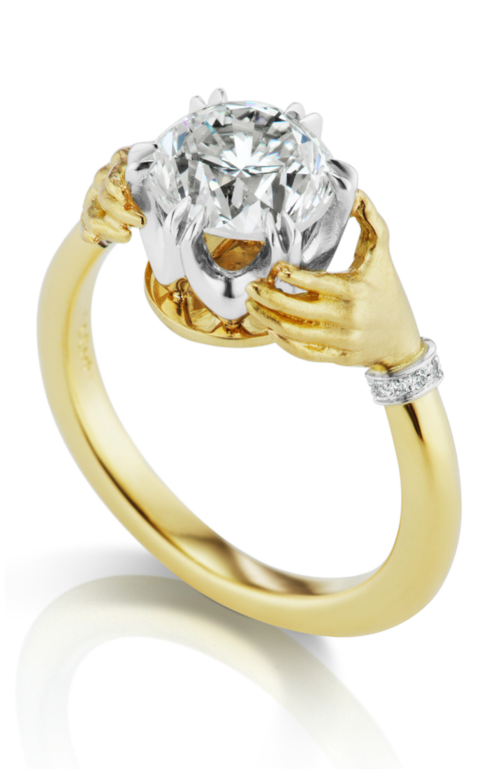 I love this Anthony Lent engagement ring! The hands are so unique.