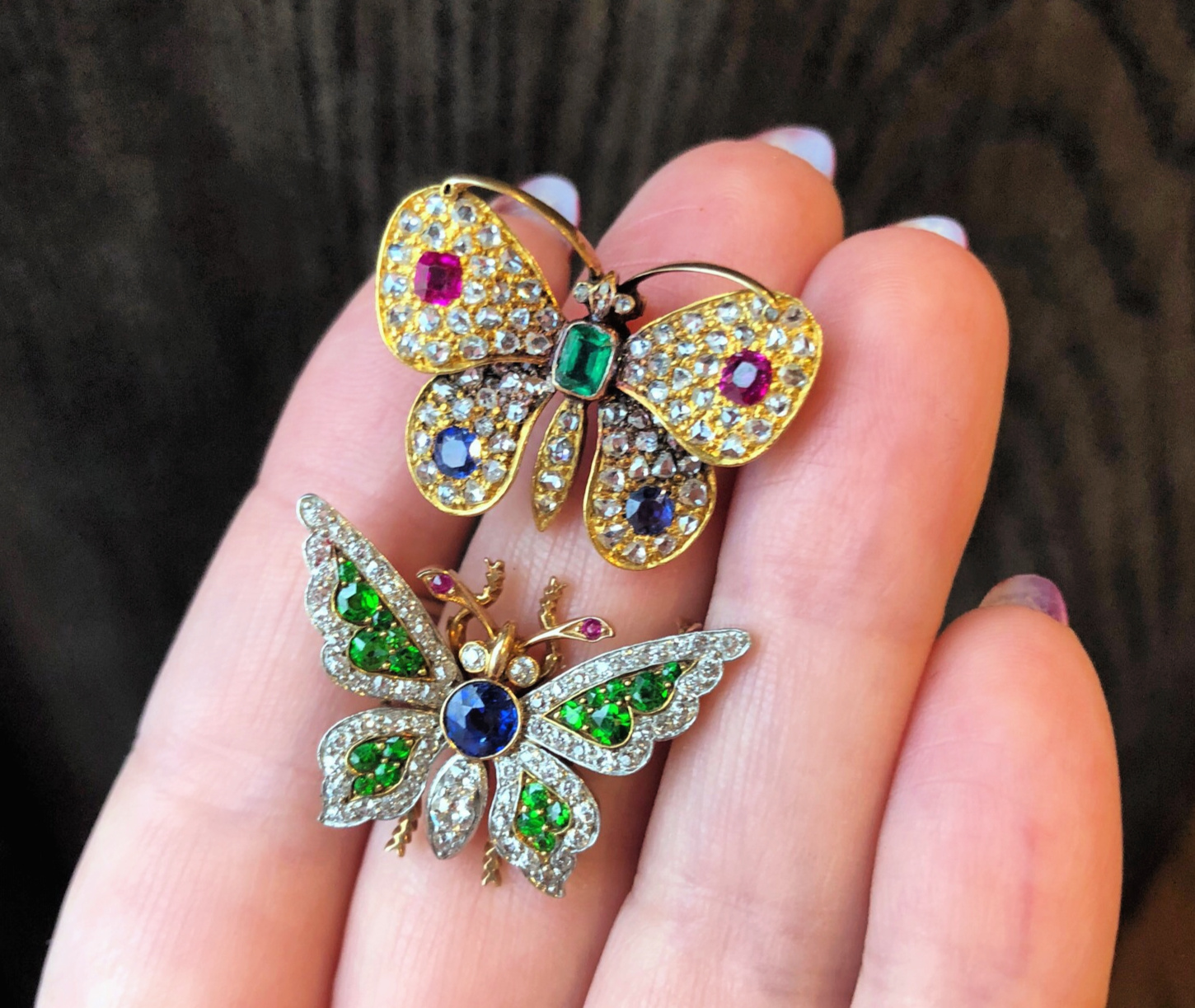 Two beautiful antique butterfly brooches with gemstones and diamonds. From Wilson's Estate Jewelry.