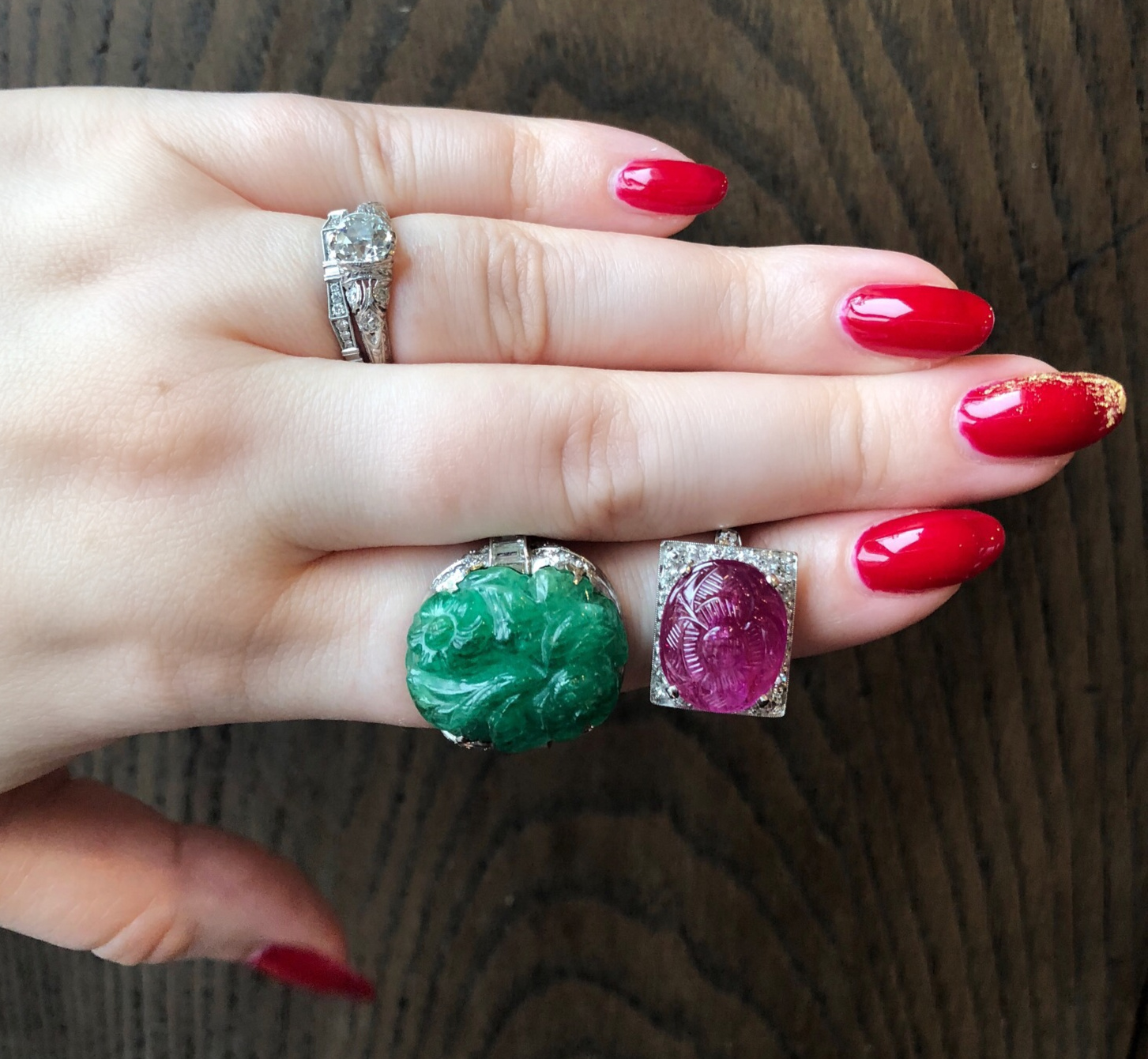 Two utterly exquisite antique rings from Wilson's Estate Jewelry!! One with a carved emerald, one with a ruby. Art Deco era.