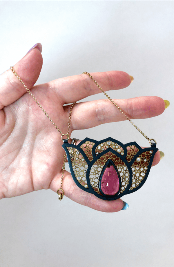 A stunning Belle Brook Designs necklace with recycled gold and a pink tourmaline.