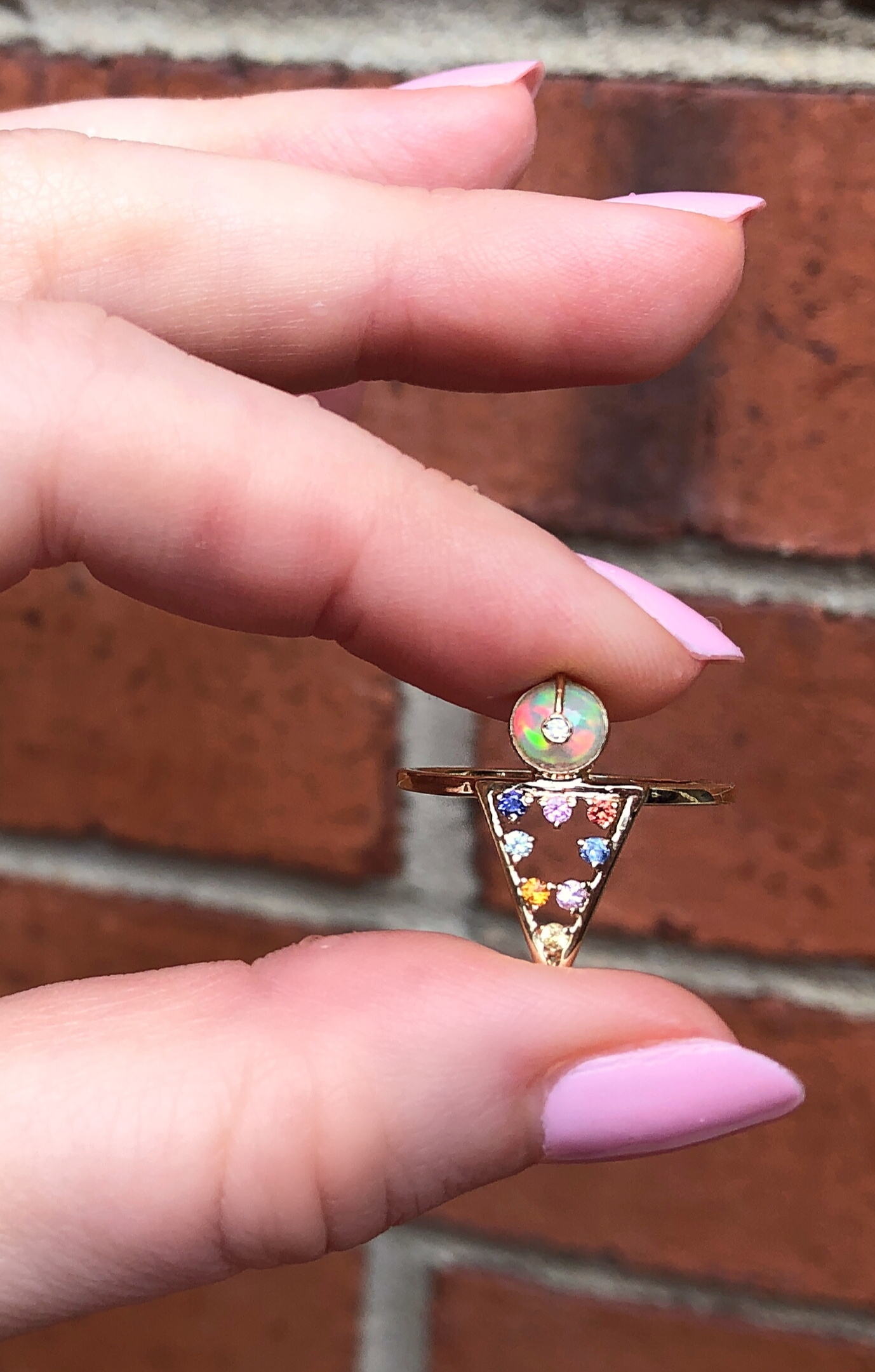 I love this ring from Loriann Jewelry's new Moderne collecton!! Opal, diamond, and colorful sapphires in gold.