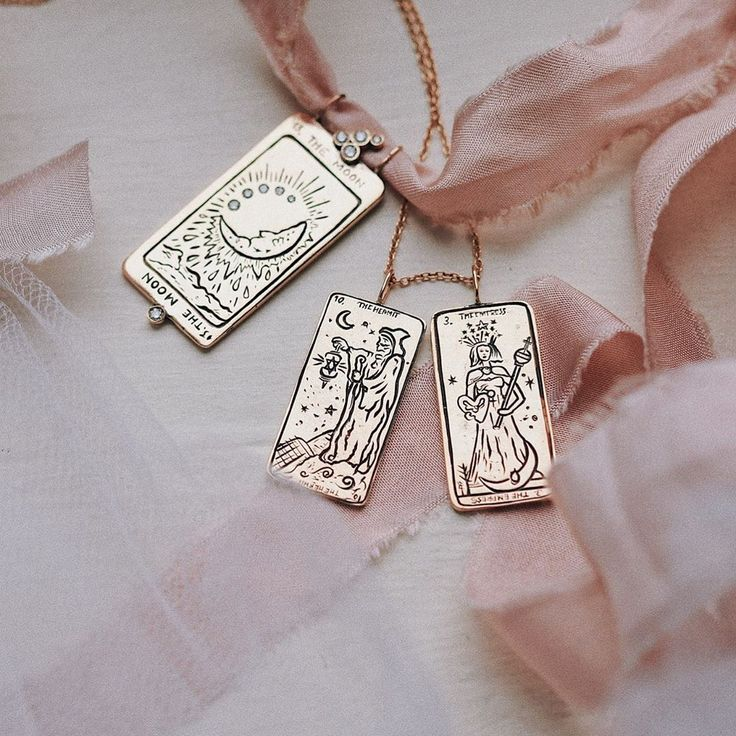 Beautiful gold tarot card necklaces by Sofia Zakia!