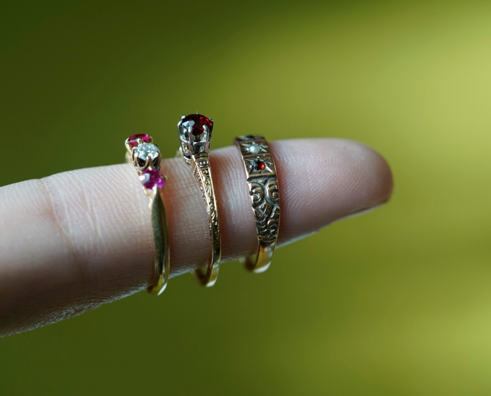 Three antique gold rings.