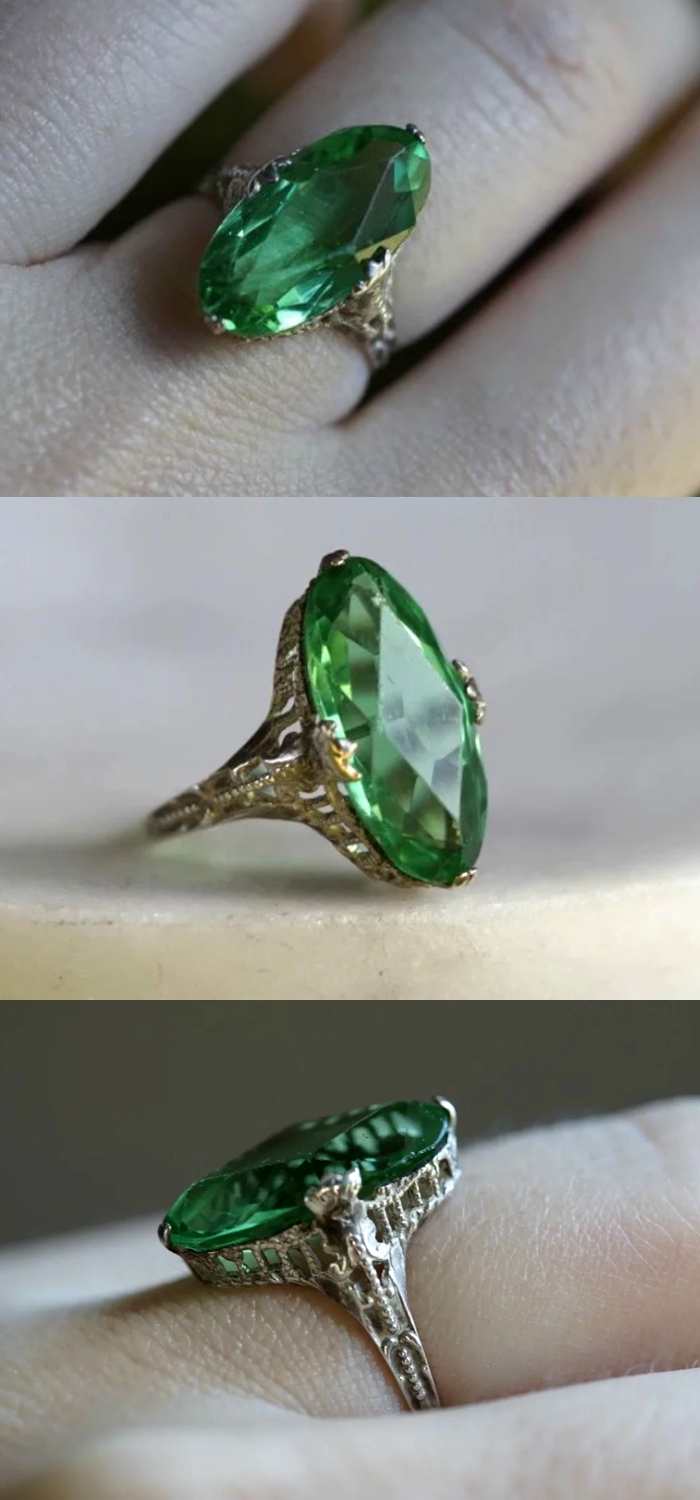 I love the filigree details on this beautiful vintage ring! Art Deco era, with green glass. For sale at Stay Gold.