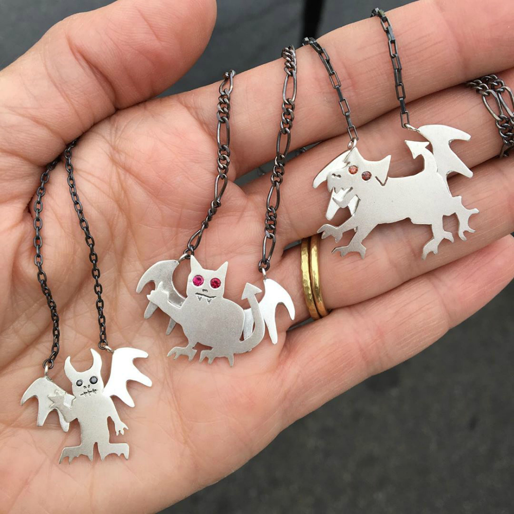 Susan Elnora dog demon, cat demon, and regular demon necklaces in silver