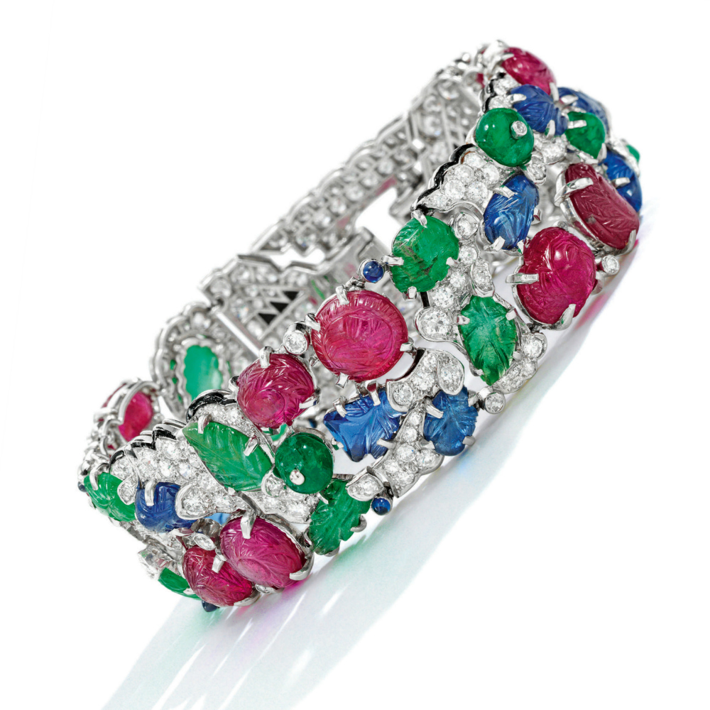 A rare and beautiful Cartier Tutti Frutti bracelet; Art Deco era, circa 1930. Diamonds with carved rubies, emeralds, and sapphires.