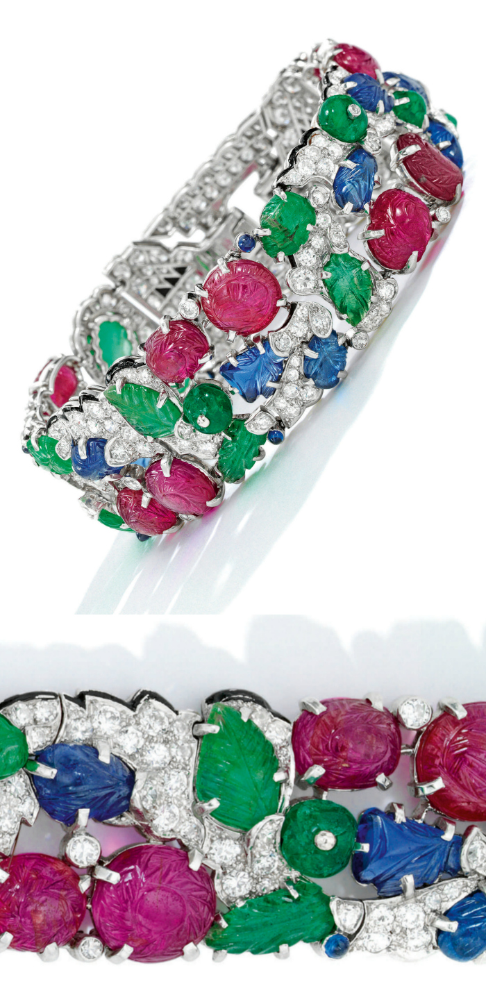 An exquisite antique Art Deco Cartier Tutti Frutti bracelet, circa 1930. Diamonds with carved rubies, emeralds, and sapphires.