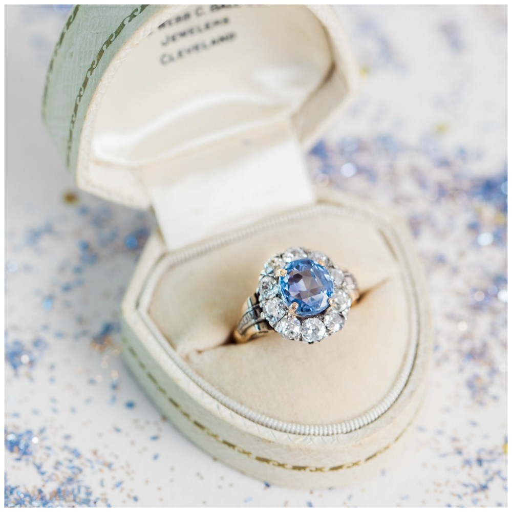 A Victorian antique engagement ring with a 2.75ct sapphire surrounded by diamonds. From Trumpet and Horn.