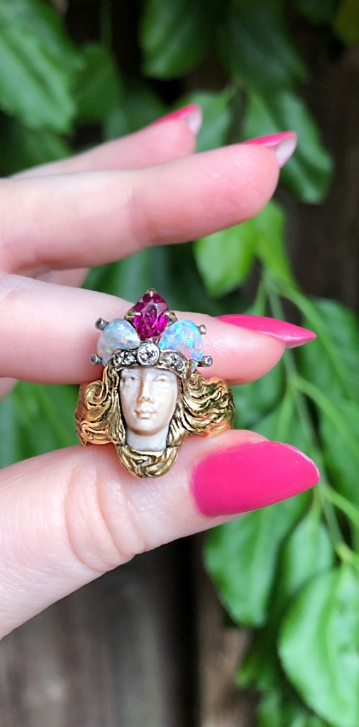 Incredible antique Art Nouveau era Empress ring from Wilson's Estate Jewelry. In gold, with opals and a ruby.