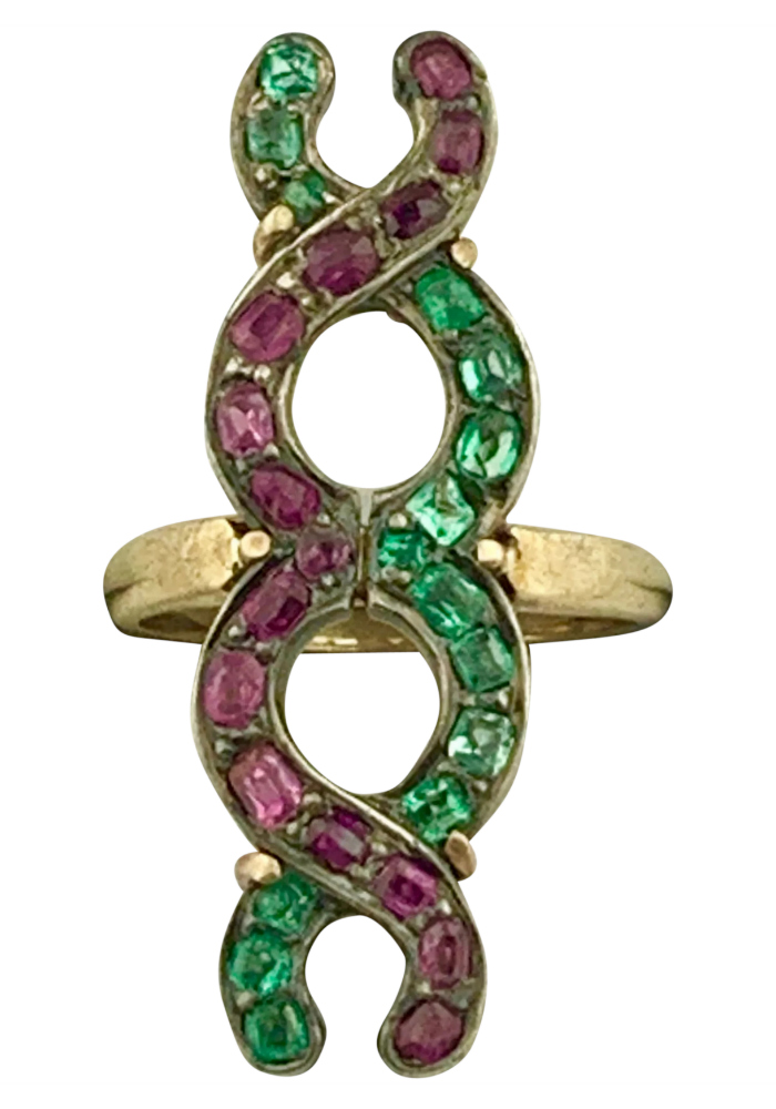 Victorian ring with emeralds and diamonds forming an eternity knot. From Okey's Secret Room on Ruby Lane.