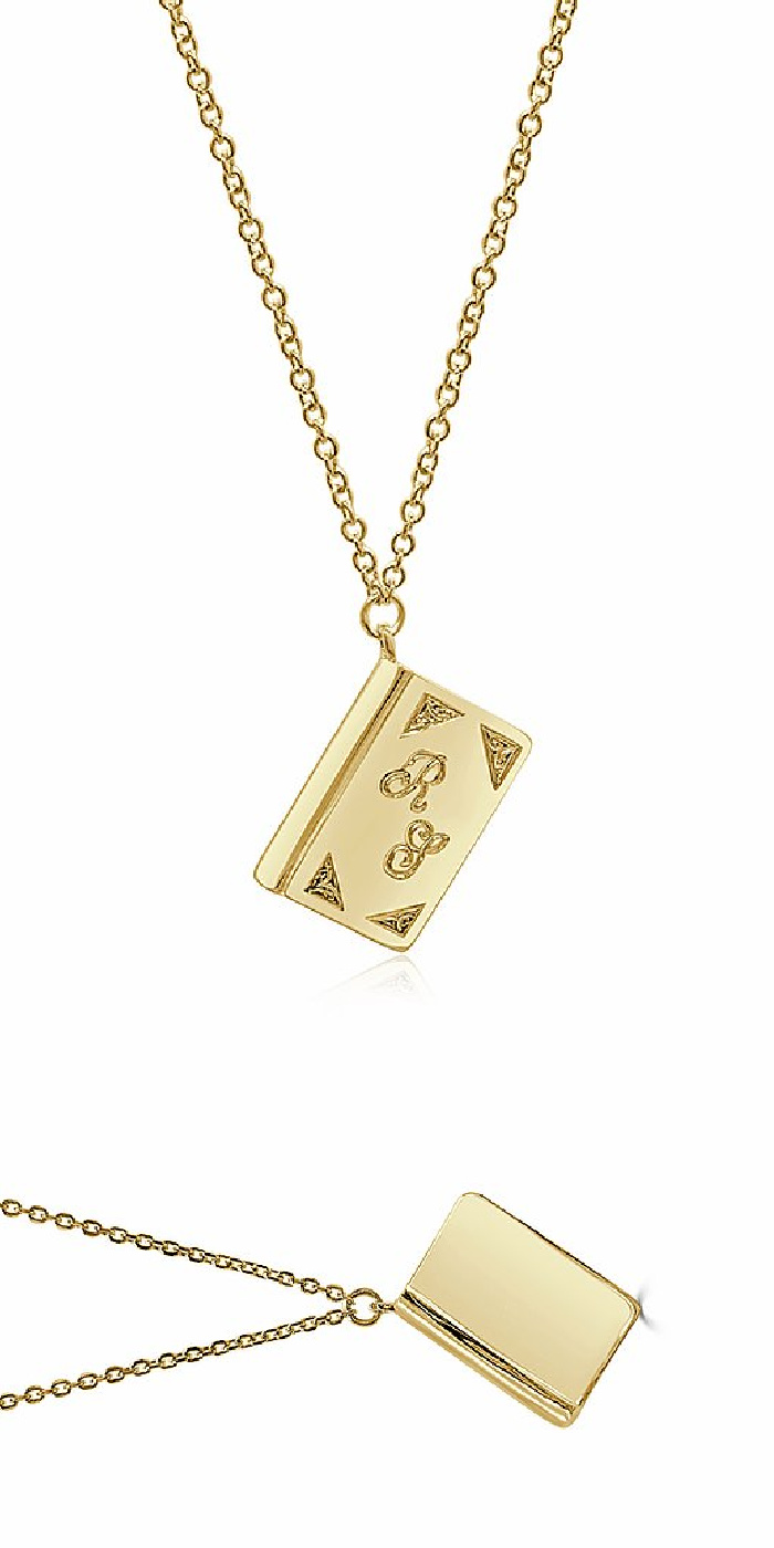 The yellow gold Book for a Book necklace from Dubin's Fine Jewelry. Each necklace sold means a book donation for nonprofit Books Between Kids.