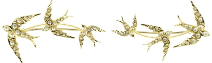An antique Edwardian era brooch in gold with pearls, showing three swallows in flight. From Carus Jewellery.