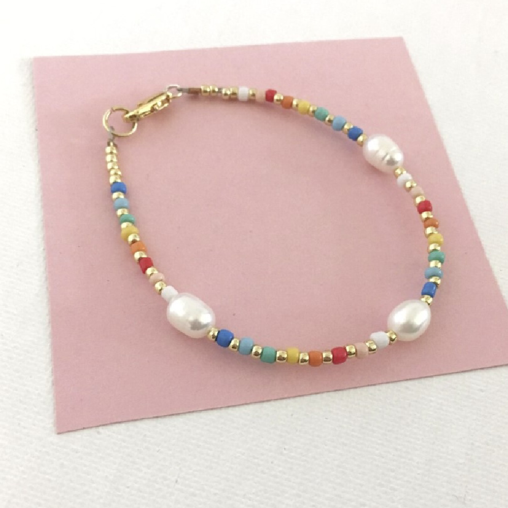 Rainbow pearls! This rainbow bead and pearl bracelet is from Pearls by Mimmi. I love the touch of gold!