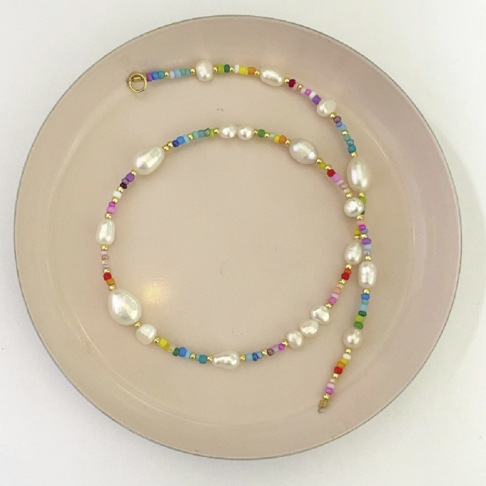 Rainbow pearls! This rainbow bead and pearl necklace is from Pearls by Mimmi.