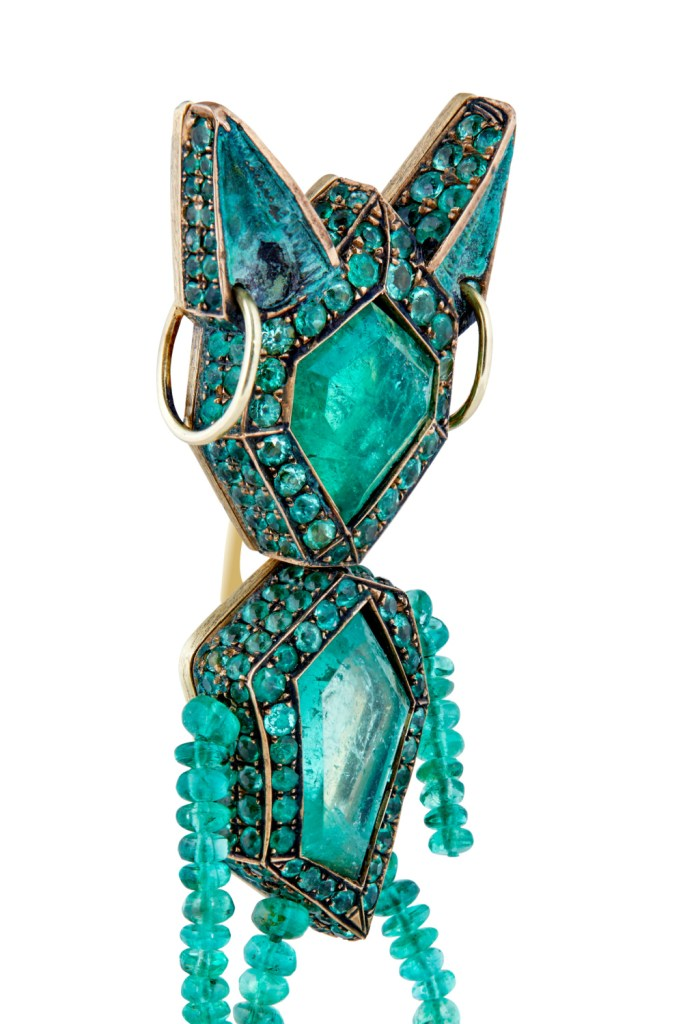 The Money brooch, by Castro. A little buddy all made of Muzo emeralds! Now in Sotheby's Brilliant & Black, an exhibition of work by Black jewelers
