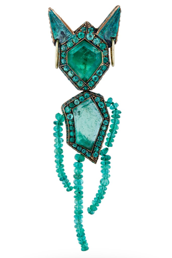 The Money brooch, by Castro. A little figure all made of Muzo emeralds! Now in Sotheby's Brilliant & Black, an exhibition of work by Black jewelers
