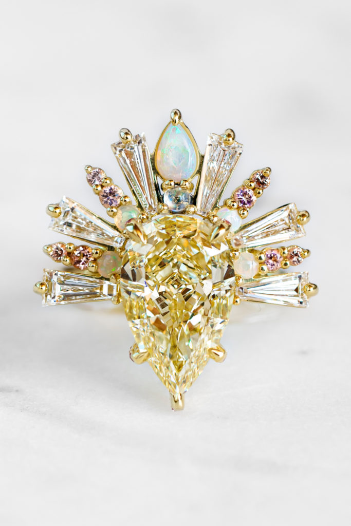 The Sunburst ring by Maggi Simpkins, with a pear-shaped yellow diamond, baguette diamonds, moonstone, peach sapphires and pink tourmaline