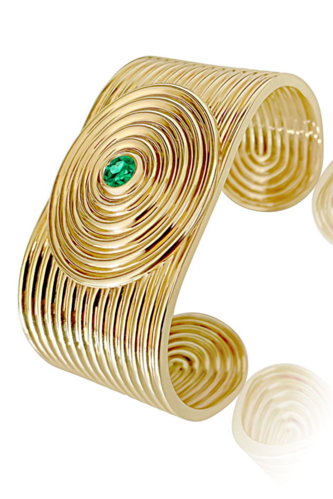 The beautiful Universum cuff bracelet by ALMASIKA. In gold with tsavorite garnet.