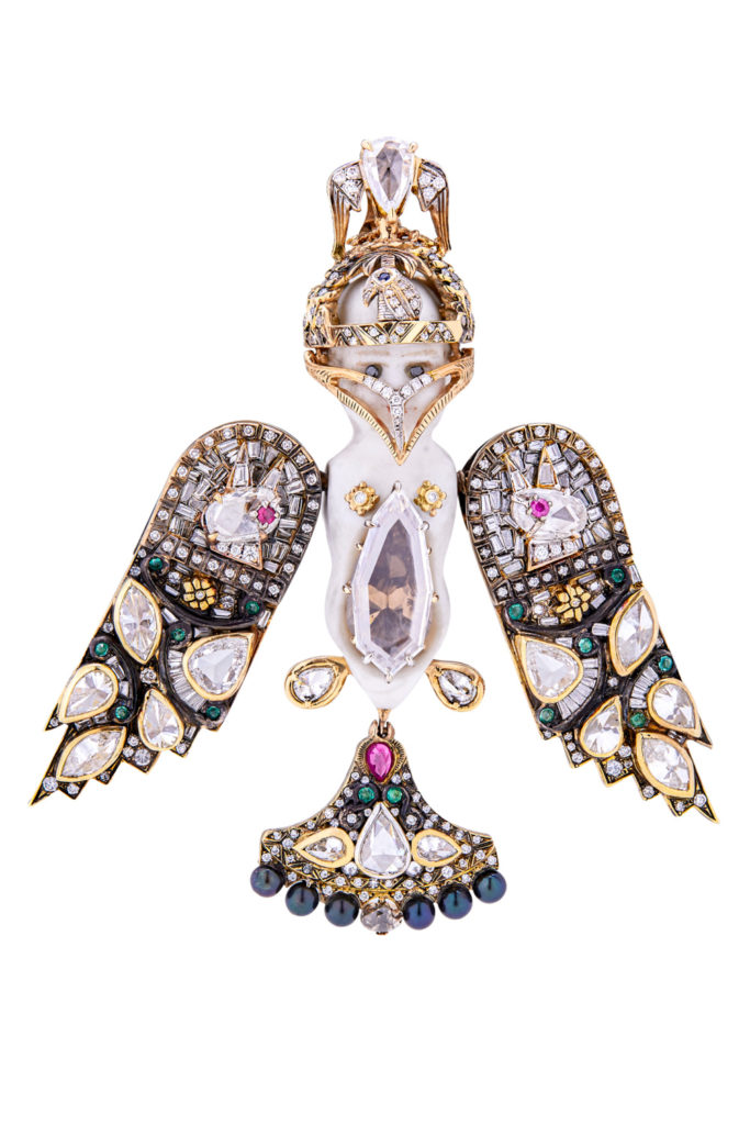 The pendant of the Bisque Doll necklace by Castro. This figure has a detachable mask and movable wings! Optional convertible chain that can be worn long or short.