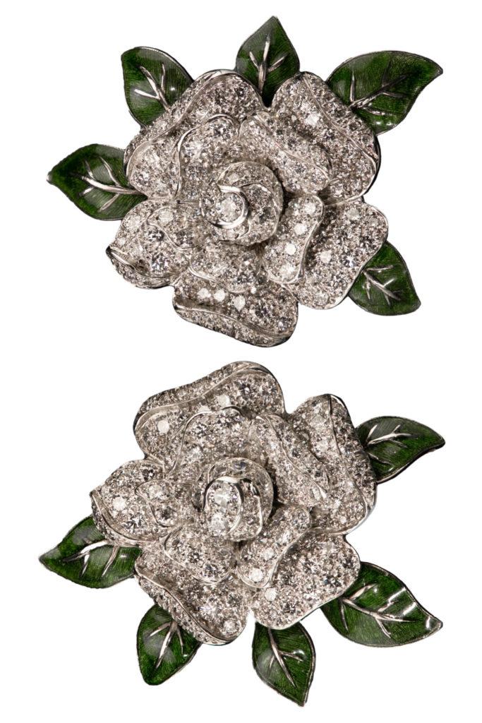 Oscar Heyman earrings in the shape of gardenia flowers, with diamonds and green enamel. From Tiina Smith.