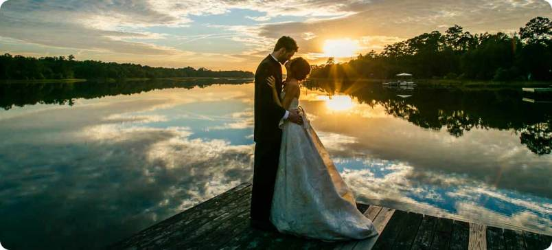 bride-and-groom-at-sunset with water reflection