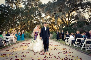 Bride and Groom Walking Down The Aisle at Boone Hall Plantation