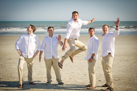 Groomsmen jumping on kiawah islan