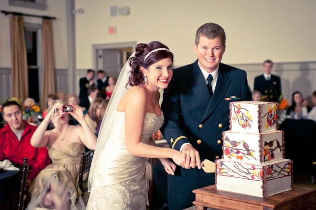 bride and groom cutting wedding cake at ion creek club