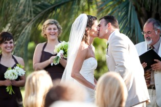 bride and groom seal it with a kiss