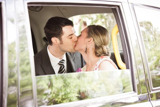 bride and groom wedding sendoff kissing in car