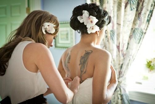 bride getting into wedding dress (2)