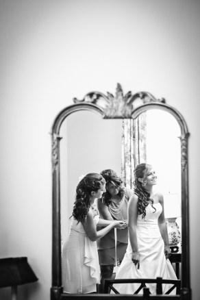 bride preparing in mirror