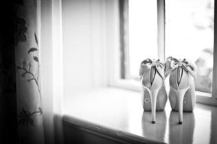 brides shoes in window of planter' sinn