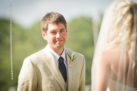 groom reacts to his bride