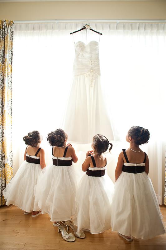 little girls admiring wedding dress