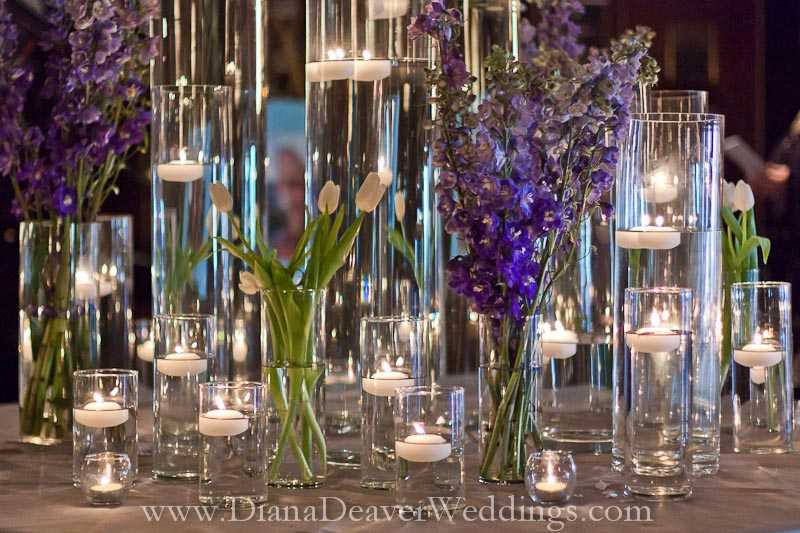 glass, flowers and candles wedding decorations captured by wedding photographer Diana Deaver in Charleston SC