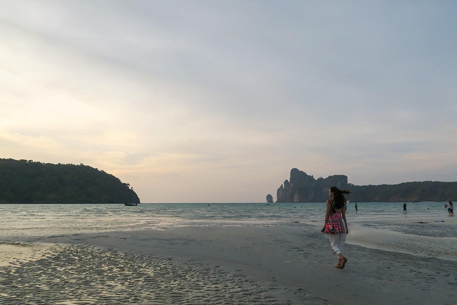 diana elizabeth blogger talkking a walk at dusk on Koh phi phi island low tide