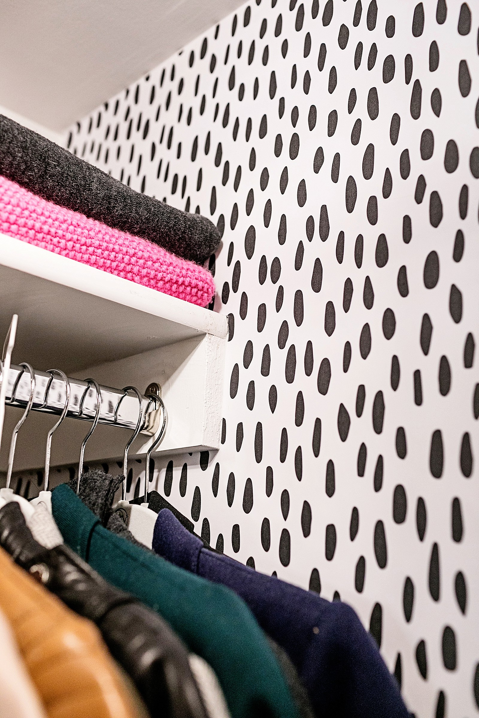 black and white spot Dalmatian look removable wallpaper in small closet