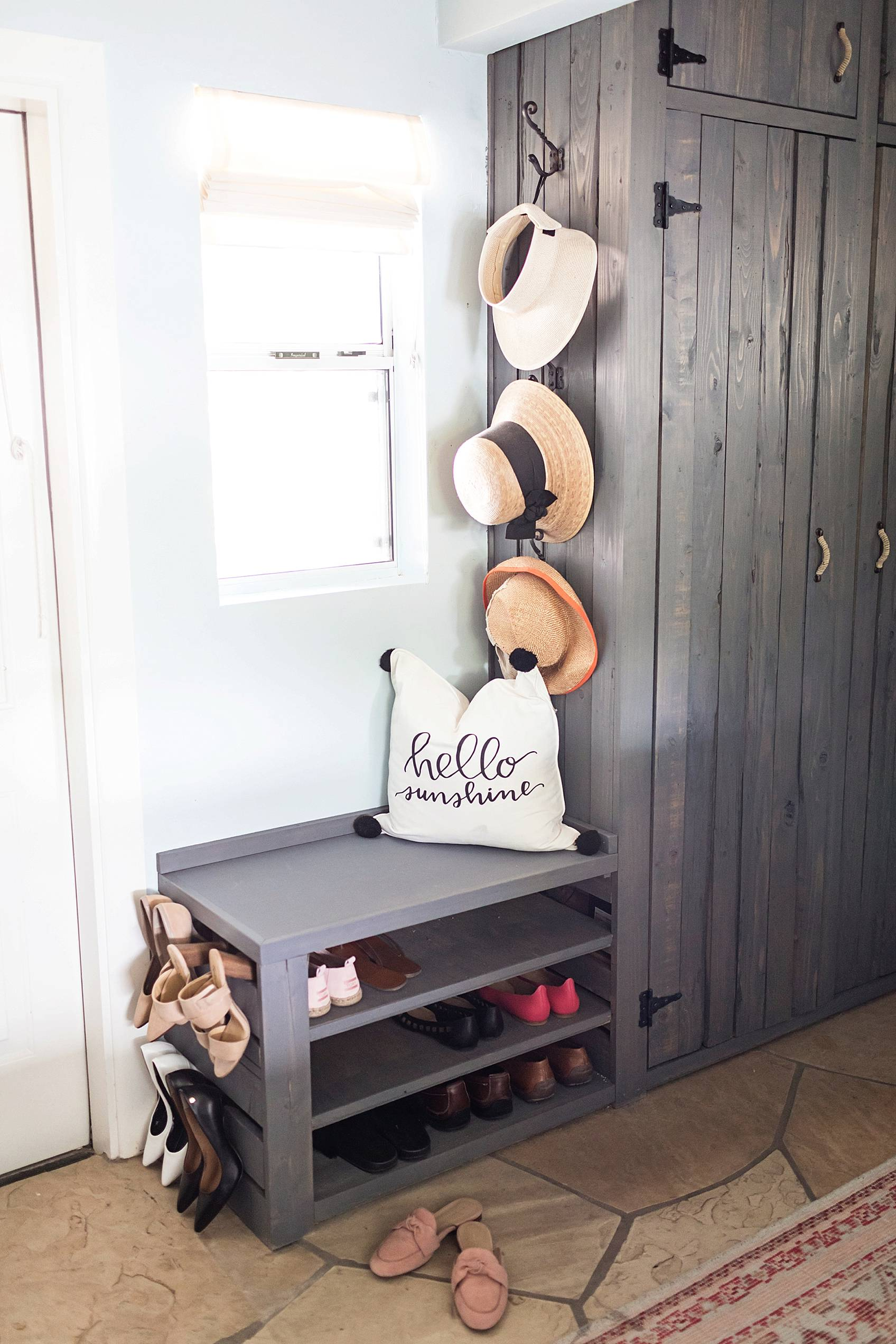 laundry mud room rustic with custom area to hang and put away shoes and hang garden hats