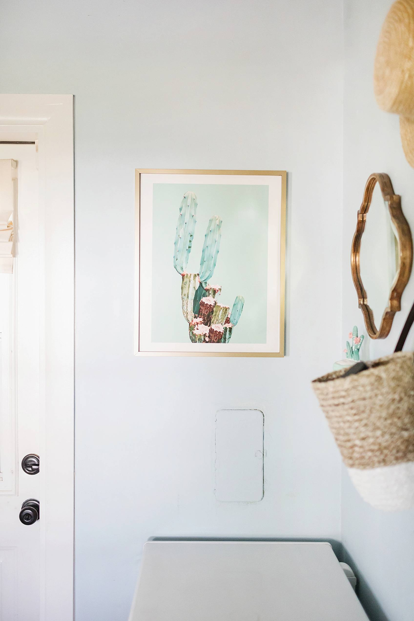 laundry mud room with custom cabinets rustic look with blue removable wallpaper in background and mint hunter fan cactus print theme