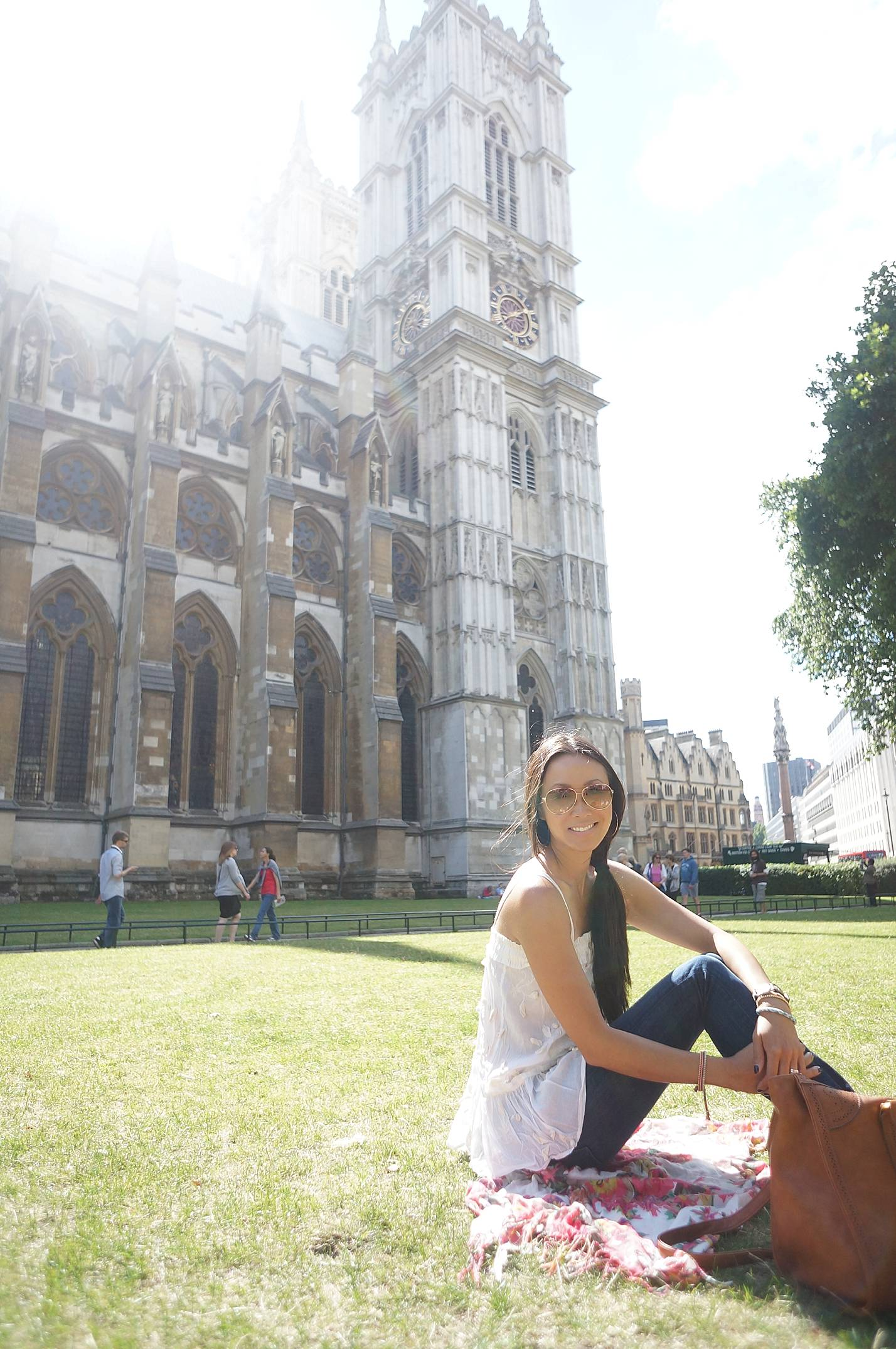 sitting on lawn of Westminster abbey